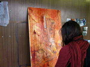 "Casey Campbell working on her painting ""Aia 10 Uheksa Viis"""